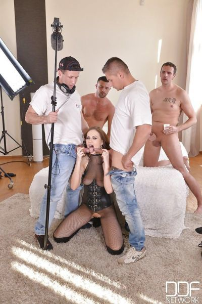 Kinky bukkake loving Euro chick Tina Kay takes blowbang in gangbang action