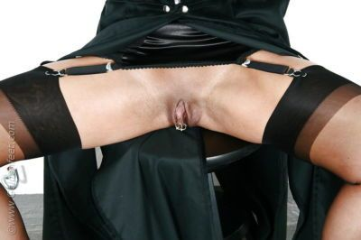 Kinky mature UK BDSM model Lady Sarah flashing pierced upskirt pussy