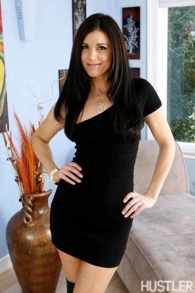 MILF India Summer strips down to stripper boots for nude posturing