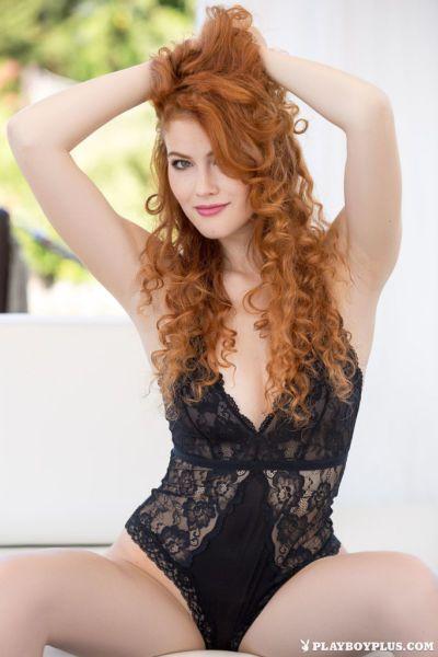 Beautiful redhead Heidi Romanova poses naked on sofa for centerfold spread