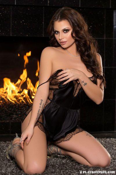 Hot centerfold model Shelly Lee slips off her sexy black lingerie