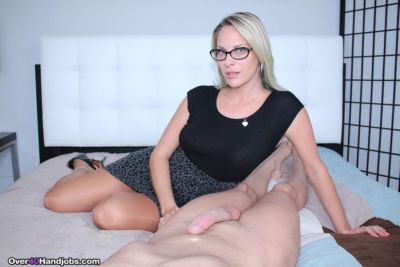 Clothed middle aged lady Vicky Vixxx jacks off a cock wearing glasses