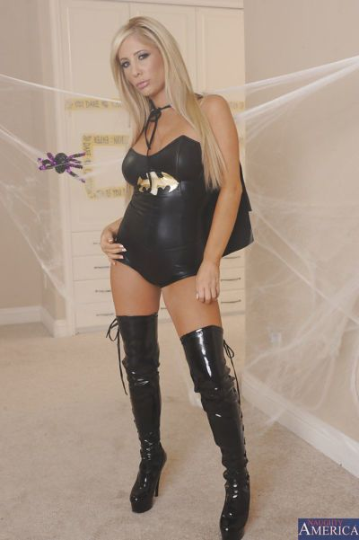 Stunning blonde in sexy batgirl outfit undressing and fingering her pussy