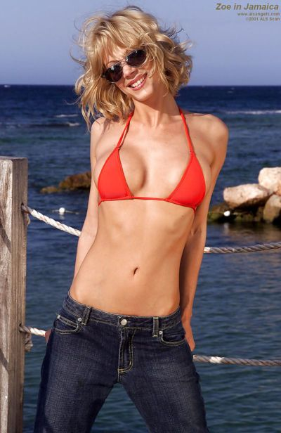 Blonde beach babe Zoe puts on sunglasses and takes off top outdoors