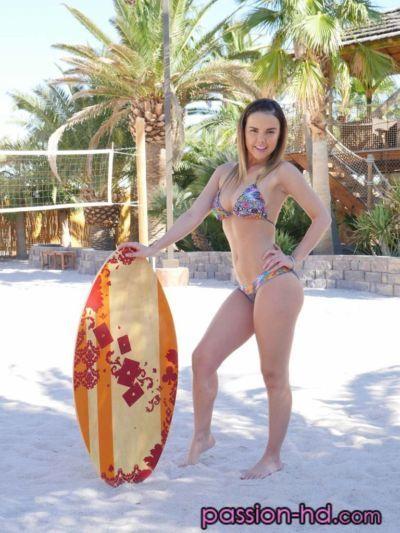 Solo girl Dillion Harper removes her bikini for nude posing at the beach
