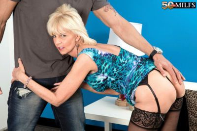 Hot mature woman Eve Bannon banging young male lover in stockings