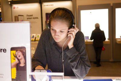 Skinny playful blonde teen Reese Berkman bending over in a store