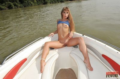 Graceful lassie with shaved gash demonstrating her goods on the boat walk