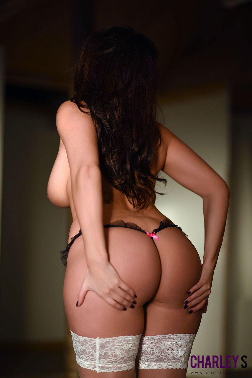 BBW solo model Charlotte Springer hikes her short dress up and over her head