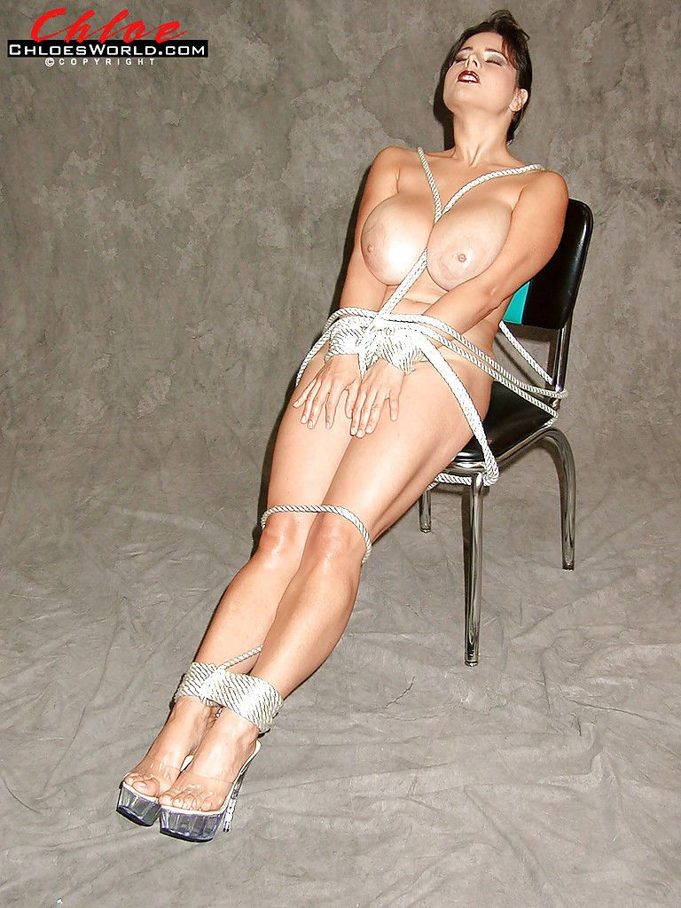 Chubby MILF Chloe Vevrier displays juggs before bound and gagged with rope