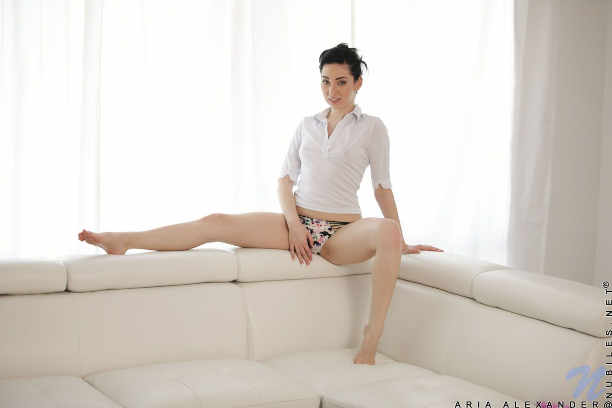 Short haired coed Aria Alexander undresses for an afternoon of masturbation