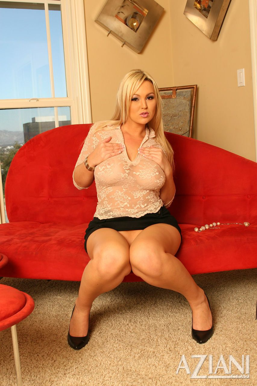 Sexy MILF Abbey Brooks hikes her black miniskirt for pussy play