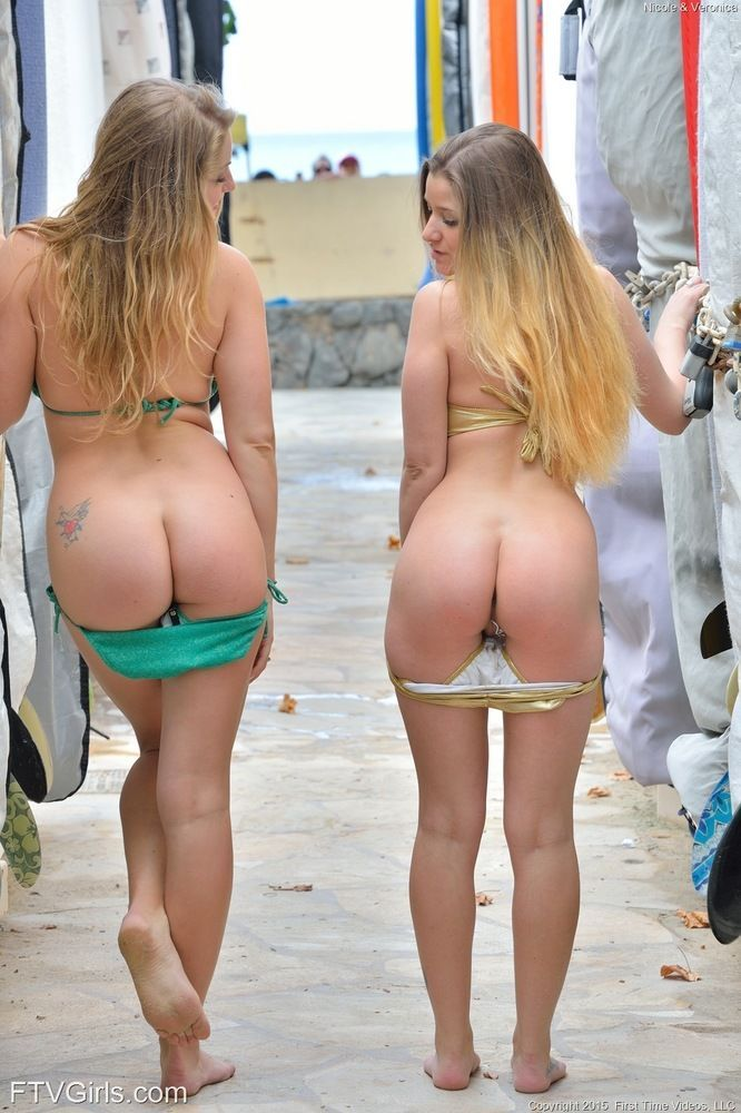 Lesbian babes peel off their bikinis in public after kissing