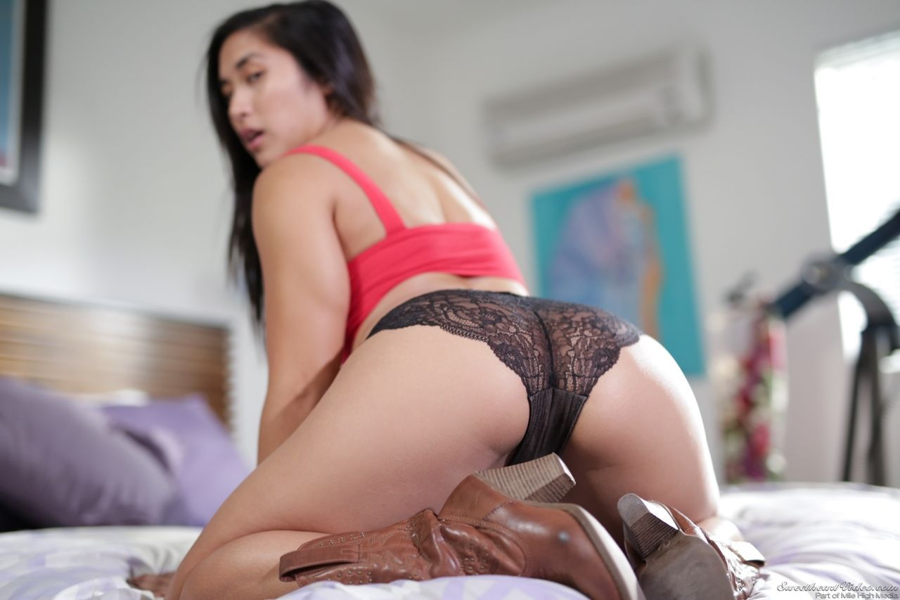 Asian solo model Mia Li strips down to cowgirl boots on her bed