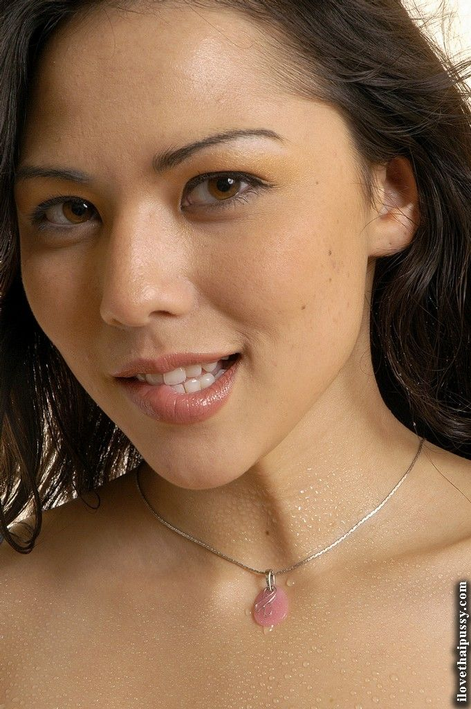 Loveable asian floosie slipping off her panties and teasing her shaved slit
