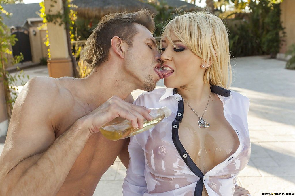 Bootylicious blonde MILF gets oiled up and fucks a big boner outdoor