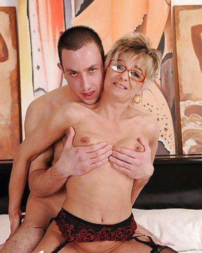 Sex-hungry granny in stockings gets fucked and facialized by younger lad