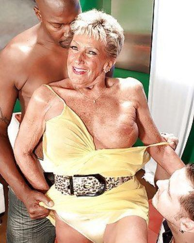 Big titted grandma having sex with a black man and a white man