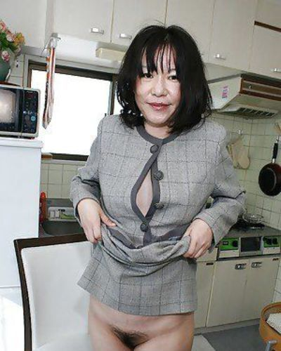 Asian lady Makiko Nakane lifting up her skirt and exposing her shaggy twat