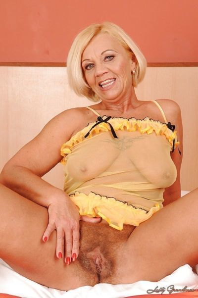 Big busted blonde granny stripping off her lingerie on the bed - part 2