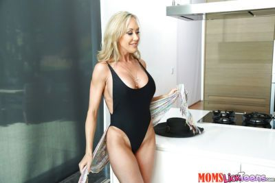Blonde mom Brandi Love freeing big tit from swimsuit before taking selfie