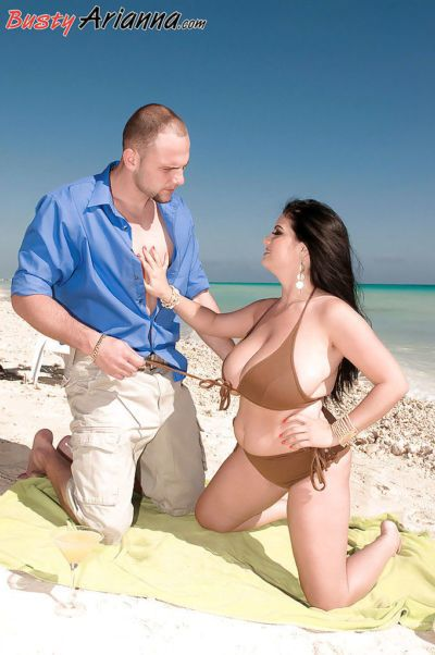 Buxom Euro mom Arianna Sinn licking balls and nipples outdoors on beach