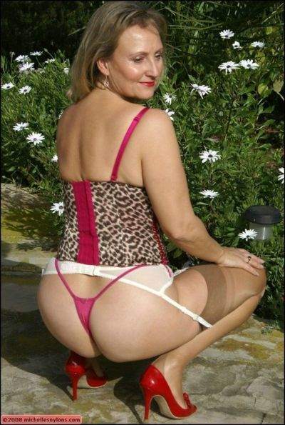 Fatty mom in nylon stockings and leopard lingerie galanting outdoor