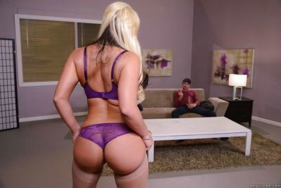 Blonde mom Phoenix Marie striking sexy non nude poses in hose and lingerie
