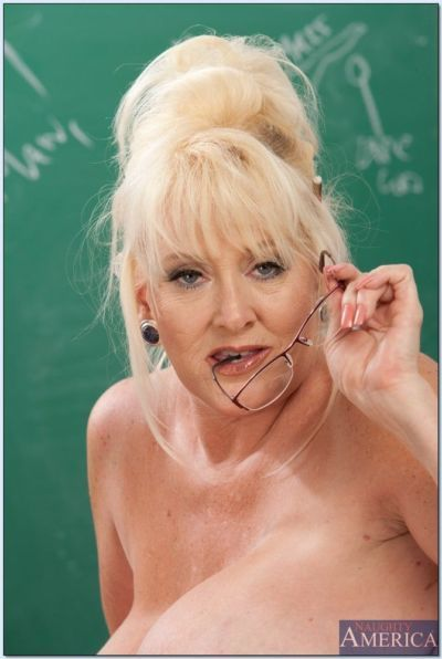 Mature teacher Kayla Kleevage denudes her giant tits in the classroom - part 2
