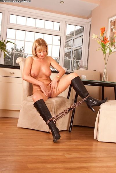 Mature lady Elaine unveiling big natural boobs while stripping down to boots - part 2