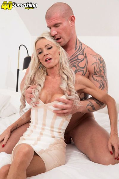 Tight mature chick with fair hair Alex Starr has sex with a tattooed dude
