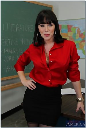 Big busted mature teacher in stockings taking off her suit and lingerie