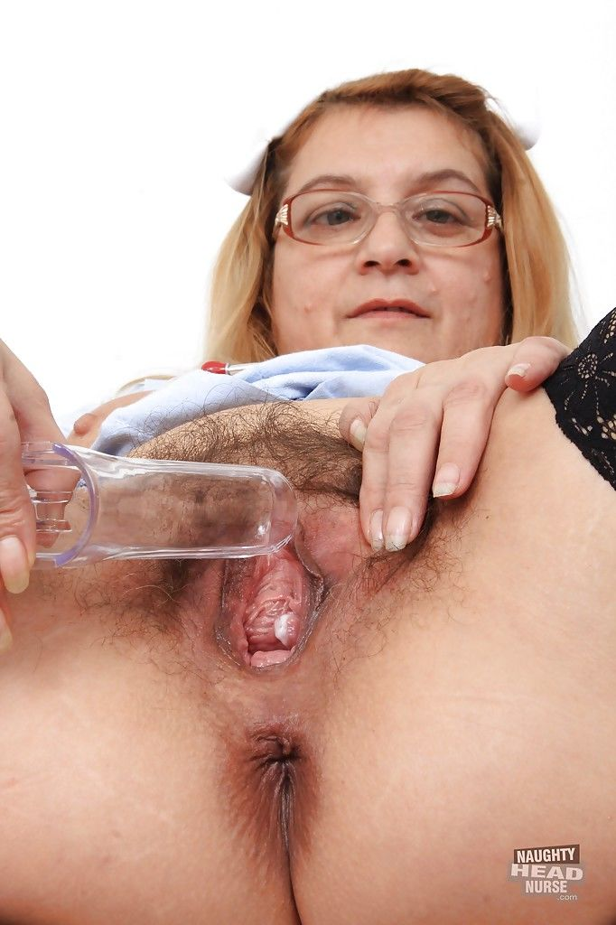 Uniformed fatty Jitule teases her mature pussy while wearing glasses