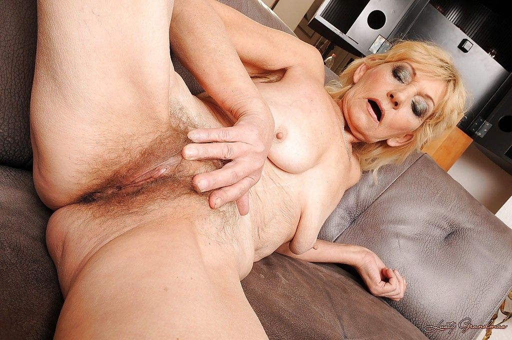 Skinny granny on high heels stripping and showcasing her hairy twat