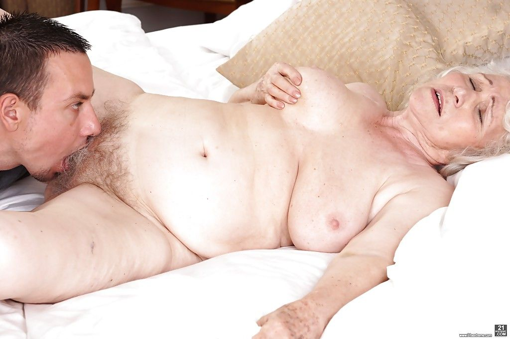 Obese granny Norma loosing huge saggy boobs in kitchen for younger man
