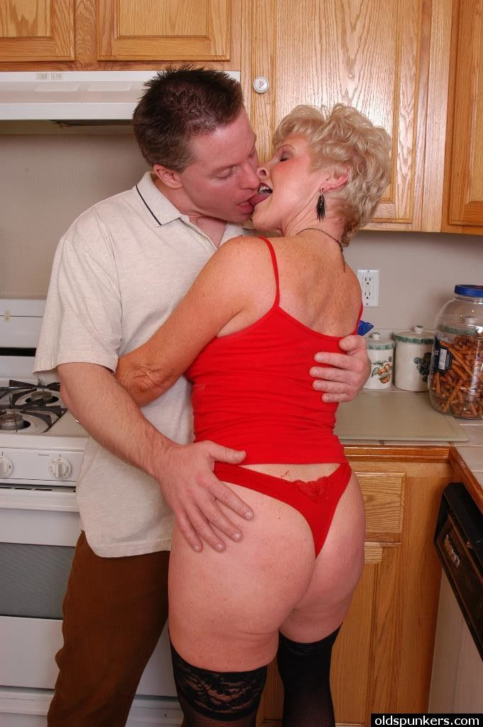 Stocking attired granny Jewel taking cumshot on boobs in kitchen