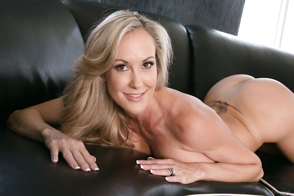Babe mom Brandi Love poses in doggy style on the leather sofa