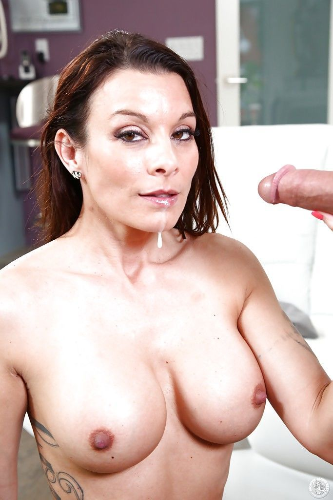 Brunette cougar Angel Reed gives a CFNM blowjob to younger man