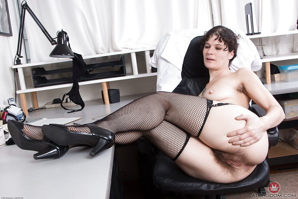 Mature brunette Sunshine shedding doctor garb before exposing hairy twat - part 2