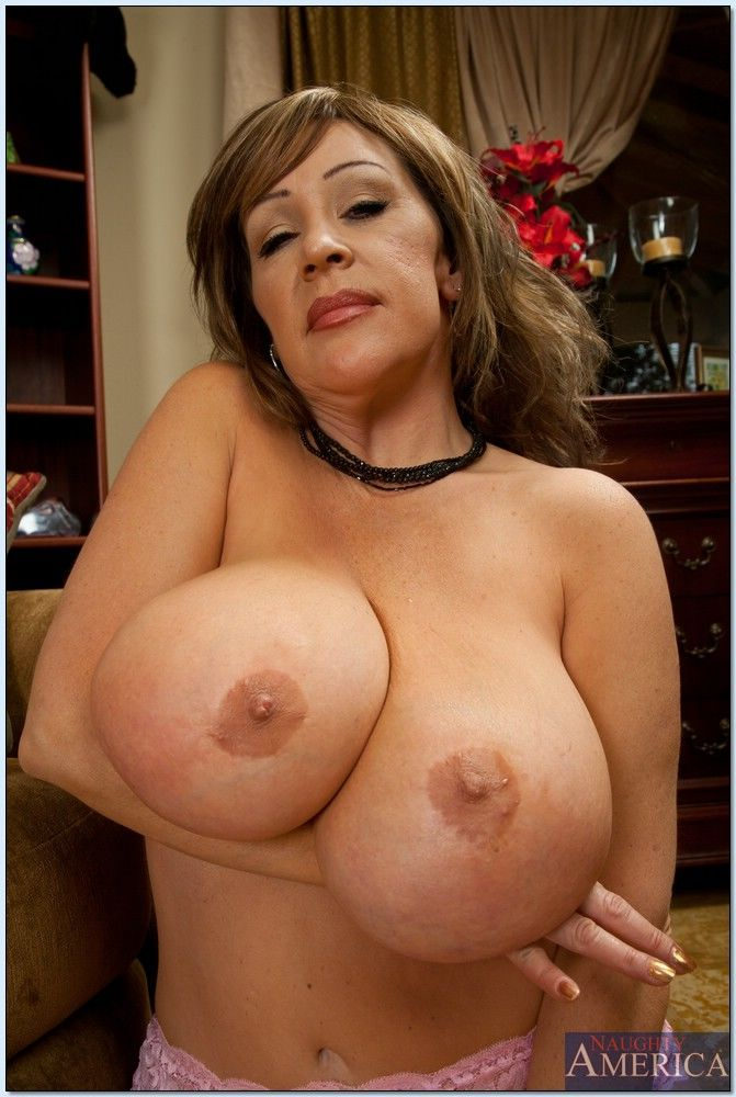Busty mature lady Kandi Cox playing with her huge boobs in stockings