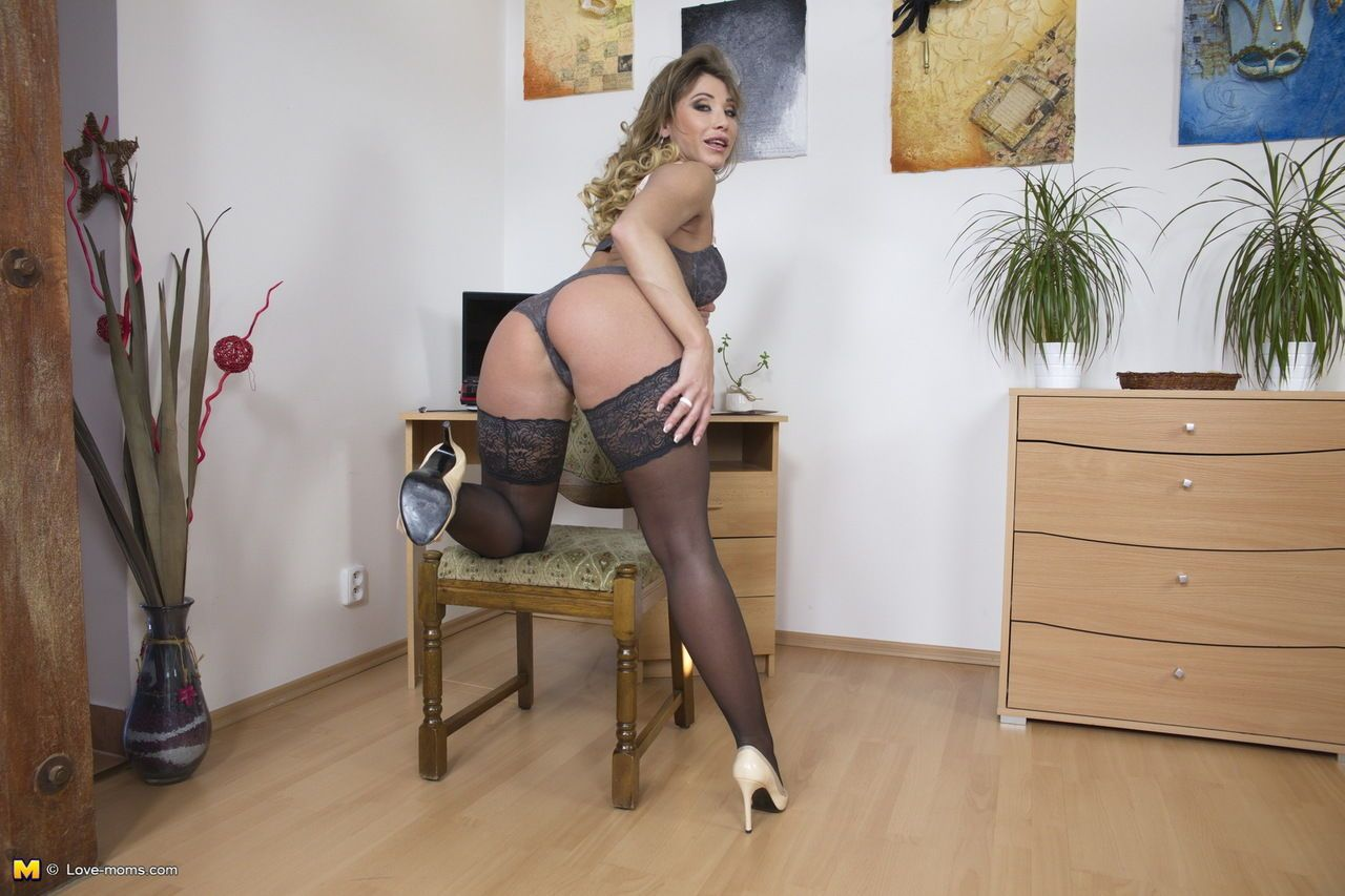 Sexy older lady strips to stockings before pulling out her big vibrator