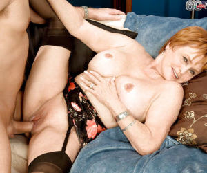 Redhead granny Valerie instructing a younger man on finer..