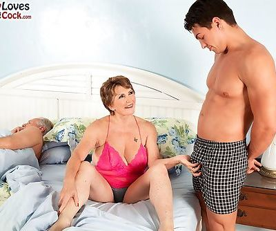 Busty granny Bea Cummins fucks a young boy while her impotent hubby watches