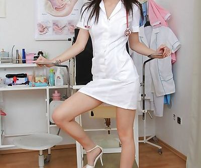 Fetish brunette nurse Belle..