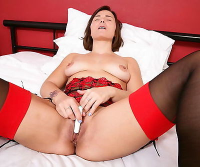 Cute British mom in stockings Jamie Ray playing with herself