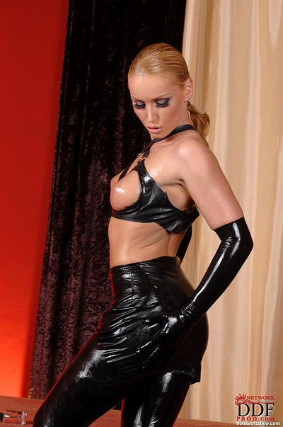 Suberb Kathia Nobili with big tits gets dressed in a latex suite