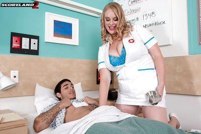 Busty blonde nurse Cameron Skye blowing two cocks in MMF threeway