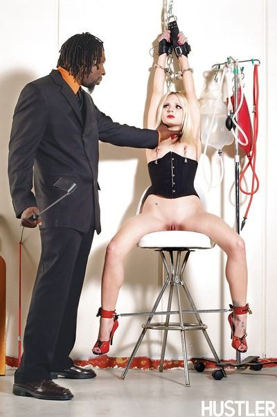 Inked blonde pornstar Faye penetrated by big black dick while chained