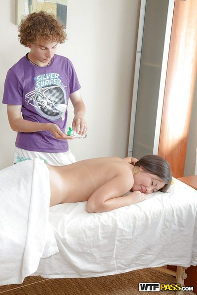 Oiled up asian slut gets fucked after massage and jizzed over her belly