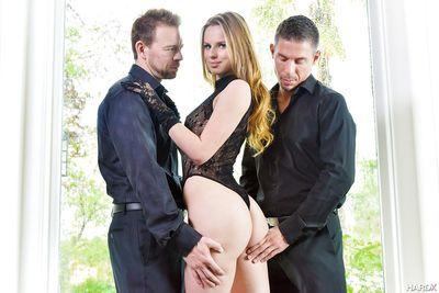 Pornstar Jillian Janson posing outdoors in sexy lingerie & baring tiny tits